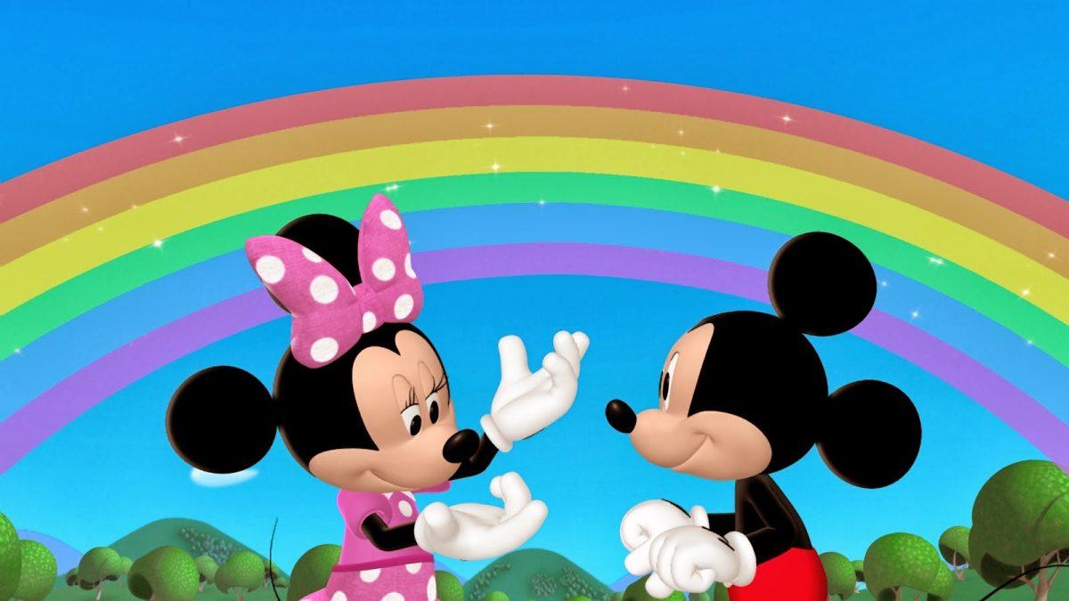 Imágen de amor de Minnie y Mickey con fondo de arcoíris